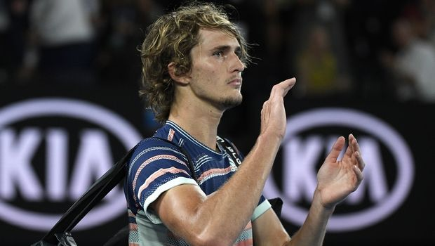 Germany's Alexander Zverev waves to the crowd after losing to Austria's Dominic Thiem in their semifinal match at the Australian Open tennis championship in Melbourne, Australia, Friday, Jan. 31, 2020. (AP Photo/Andy Brownbill)