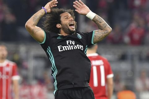 Real Madrid's Marcelo celebrates his equalizing goal during the semifinal first leg soccer match between FC Bayern Munich and Real Madrid at the Allianz Arena stadium in Munich, Germany, Wednesday, April 25, 2018. (AP Photo/Kerstin Joensson)