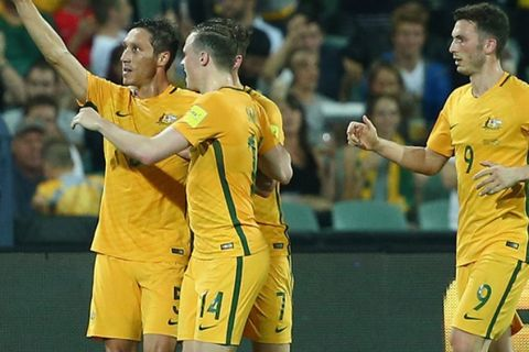 ADELAIDE, AUSTRALIA - MARCH 24:  Mark Milligan of Australia celebrates with team mates after scoring a penalty during the 2018 FIFA World Cup Qualification match between the Australia Socceroos and Tajikistan at the Adelaide Oval on March 24, 2016 in Adelaide, Australia.  (Photo by Robert Cianflone/Getty Images)