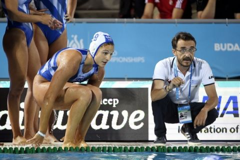 Head coach Georgios Morfesis of Greece instructs his players during a break of the women's water polo quarterfinal match between Greece and Spain at the 17th FINA Swimming World Championships in Hajos Alfred National Swimming Pool in Budapest, Hungary, Monday, July 24, 2017. (Szilard Koszticsak/MTI via AP)