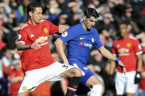 Manchester United's Nemanja Matic, left, challenges for the ball with Chelsea's Alvaro Morata during the English Premier League soccer match between Manchester United and Chelsea at the Old Trafford stadium in Manchester, England, Sunday, Feb. 25, 2018. (AP Photo/Rui Vieira)