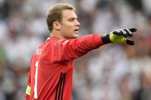 Germany goalkeeper Manuel Neuer gestures during the Euro 2016 Group C soccer match between Northern Ireland and Germany at the Parc des Princes stadium in Paris, France, Tuesday, June 21, 2016. (AP Photo/Martin Meissner)
