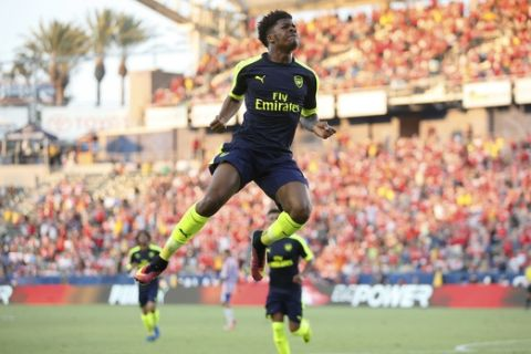 Arsenal's Chuba Akpom leaps after scoring gainst Chivas Guadalajara during the second half of a friendly soccer match in Carson, Calif., Sunday, July 31, 2016. (AP Photo/Danny Moloshok)