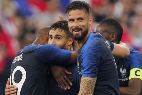 France's Nabil Fekir, center right, is congratulated by his teammates after scoring his side's 2nd goal during a friendly soccer match between France and Ireland at the Stade de France stadium, in Saint Denis, north of Paris, France, Monday, May, 28, 2018. (AP Photo/Thibault Camus)
