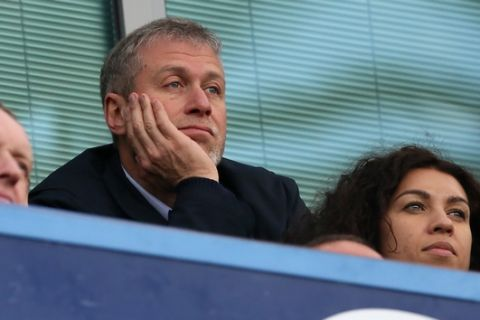 Chelsea FC Russian owner Roman Abramovich watches his side play Arsenal during their English Premier League soccer match between Chelsea and Arsenal at Stamford Bridge stadium in London, Saturday, March,  22, 2014. (AP Photo/Alastair Grant)