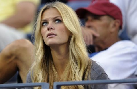 Fashion model Brooklyn Decker watches her husband, Andy Roddick of the United States, during his match against John Isner of the United States in the third round of the U.S. Open tennis tournament in New York, Saturday, Sept. 5, 2009. (AP Photo/Paul J. Bereswill)