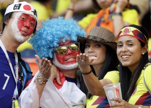 Suporters of Japan and Colombia pose after the group H match between Colombia and Japan at the 2018 soccer World Cup in the Mordavia Arena in Saransk, Russia, Tuesday, June 19, 2018. (AP Photo/Mark Baker)
