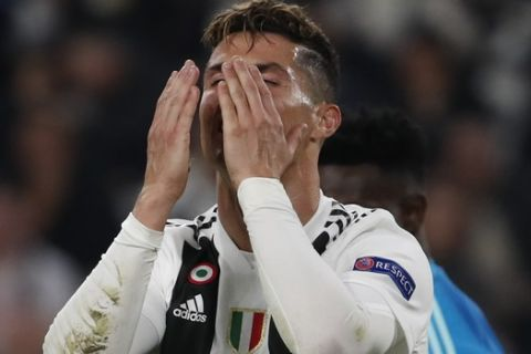 Juventus' Cristiano Ronaldo reacts after missing a scoring chance during the Champions League quarter final, second leg soccer match between Juventus and Ajax, at the Allianz stadium in Turin, Italy, Tuesday, April 16, 2019. (AP Photo/Antonio Calanni)