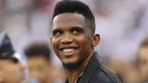 Soccer player Samuel Eto'o watches warmups before an International Champions Cup soccer match between Atletico Madrid and Real Madrid, Friday, July 26, 2019, in East Rutherford, N.J. Atletico Madrid won 7-3. (AP Photo/Steve Luciano)