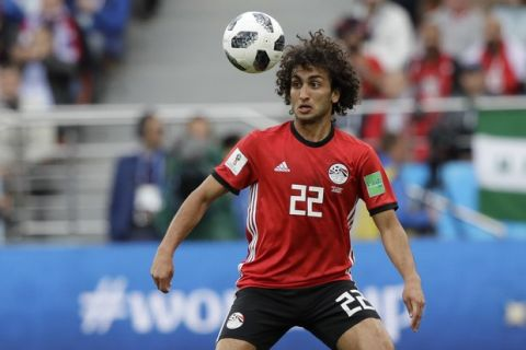 Egypt's Amr Warda watches the ball during the group A match between Egypt and Uruguay at the 2018 soccer World Cup in the Yekaterinburg Arena in Yekaterinburg, Russia, Friday, June 15, 2018. (AP Photo/Mark Baker)