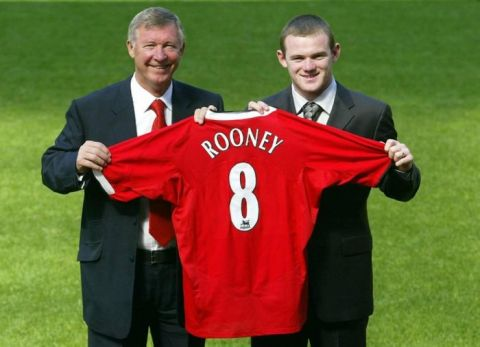 New Manchester United signing Wayne Rooney (R) with manager Sir Alex Ferguson at a press conference at Manchester United's Old Trafford ground, Manchester.