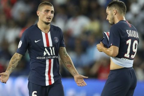 PSG's Marco Verratti, left, talks to PSG's Pablo Sarabia during the French League One soccer match between Paris Saint Germain and Toulouse at the Parc des Princes Stadium in Paris, France, on Sunday, Aug. 25, 2019. (AP Photo/David Vincent)