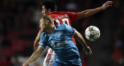 Zenit's defender Alexander Anyukov (FRONT) vies with Benfica's Argentinian midfielder Nicolas Gaitan during the UEFA Champions League round of 16 football match SL Benfica vs FC Zenith Saint-Petersburg at the Luz stadium in Lisbon on February 16, 2016. / AFP / FRANCISCO LEONG        (Photo credit should read FRANCISCO LEONG/AFP/Getty Images)