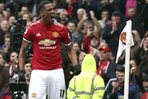Manchester United's Anthony Martial celebrates scoring his side's first goal of the game during the English Premier League soccer match between Manchester United and Tottenham Hotspur,  at Old Trafford, in Manchester, England, Saturday, Oct.  28, 2017. (Martin Rickett/PA via AP)