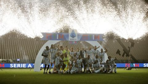 Juventus players celebrate winning an unprecedented ninth consecutive Italian Serie A soccer title, at the end of the a Serie A soccer match between Juventus and Roma, at the Allianz stadium in Turin, Italy, Saturday, Aug.1, 2020. (AP Photo/Luca Bruno)