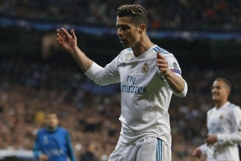 Real Madrid's Cristiano Ronaldo reacts during a Champions League quarter-final, 2nd leg soccer match between Real Madrid and Juventus at the Santiago Bernabeu stadium in Madrid, Spain, Wednesday, April 11, 2018. (AP Photo/Paul White)