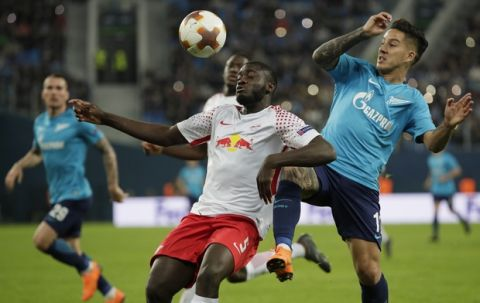 Leipzig's Dayot Upamecano, center challenges for the ball with Zenit's Sebastian Driussi, right, during the Europa League round of sixteen second leg soccer match between Zenit St. Petersburg and Leipzig, at the Saint Petersburg stadium in St.Petersburg, Russia, Thursday, March 15, 2018. (AP Photo/Dmitri Lovetsky)