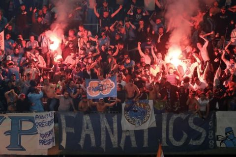 Marseille's fans celebrate after Rolando scored his side's first goal in the additional time during the Europa League semifinal second leg soccer match between FC Salzburg and Olympique Marseille in Salzburg, Austria, Thursday, May 3, 2018. (AP Photo/Matthias Schrader)