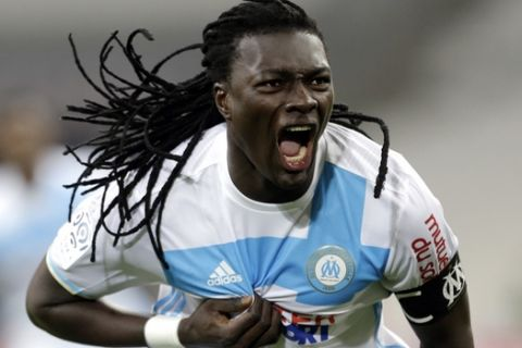 Marseille's forward Bafetimbi Gomis, reacts after scoring, during the League One soccer match between Marseille and Montpellier, at the Velodrome Stadium, in Marseille, southern France, Friday, Jan.27, 2017. (AP Photo/Claude Paris)