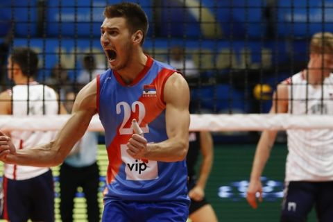 Serbia's Aleksandar Okolic celebrates his team's victory over the U.S. after a Volleyball World League semifinal game at the Maracanazinho gymnasium in Rio de Janeiro, Brazil, Saturday, July 18, 2015. Serbia won 3-2 and is qualified to the finals. (AP Photo/Leo Correa)