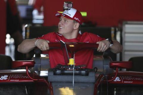 Mick Schumacher prepares for the test drive in his new formula 2 Prema racing car at the Yas Marina Circuit in Abu Dhabi, United Arab Emirates, Friday, Nov. 30, 2018. (AP Photo/Kamran Jebreili)