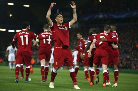 Liverpool's Roberto Firmino celebrates after scoring his side's fifth goal during the Champions League semifinal, first leg, soccer match between Liverpool and AS Roma at Anfield Stadium, Liverpool, England, Tuesday, April 24, 2018. (AP Photo/Dave Thompson)