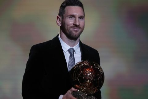Barcelona's soccer player Lionel Messi holds the trophy of the Golden Ball award ceremony in Paris, Monday, Dec. 2, 2019. Messi won the Ballon d'Or for sixth time. (AP Photo/Francois Mori)