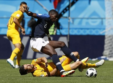 France's Paul Pogba, above vies for the ball with Australia's Mathew Leckie during the group C match between France and Australia at the 2018 soccer World Cup in the Kazan Arena in Kazan, Russia, Saturday, June 16, 2018. (AP Photo/Darko Bandic)