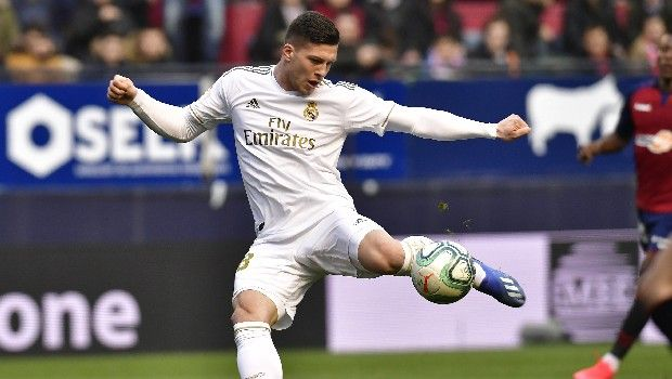 Real Madrid's Luka Jovic kicks the ball to score during the Spanish La Liga soccer match between Osasuna and Real Madrid at El Sadar stadium in Pamplona, northern Spain, Sunday, Feb. 9, 2020. (AP Photo/Alvaro Barrientos)