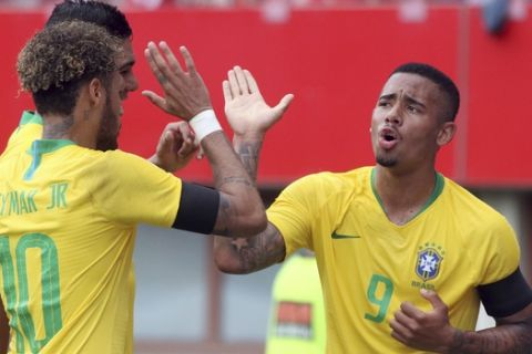 Brazil's Gabriel Jesus, right, celebrates with teammates after scoring his side's opening goal during a friendly soccer match between Austria and Brazil at the Ernst Happel Stadium in Vienna, Austria, Sunday, June 10, 2018. (AP Photo/Ronald Zak)