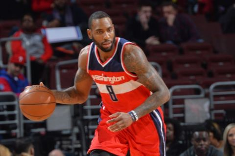 PHILADELPHIA,PA - FEBRUARY 27: Rasual Butler #8 of the Washington Wizards dribbles up the court against the Philadelphia 76ers at Wells Fargo Center on February 27, 2015 in Philadelphia, Pennsylvania NOTE TO USER: User expressly acknowledges and agrees that, by downloading and/or using this Photograph, user is consenting to the terms and conditions of the Getty Images License Agreement. Mandatory Copyright Notice: Copyright 2015 NBAE (Photo by Jesse D. Garrabrant/NBAE via Getty Images)
