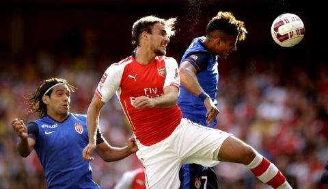 Arsenal's Ignasi Miquel, center, competes for the ball with AS Monaco's Nabil Dirar, right, beside Radamel Falcao during the Emirates Cup soccer match between Arsenal and AS Monaco at Arsenal's Emirates Stadium in London, Sunday, Aug. 3, 2014.  (AP Photo/Matt Dunham)
