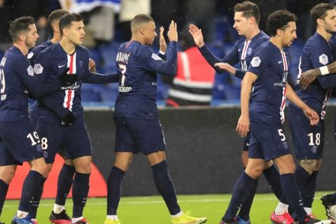 PSG's Kylian Mbappe, centre, celebrates with PSG's Julian Draxler, centre right, after scoring his side's second goal during the French League One soccer match between Paris-Saint-Germain and Dijon, at the Parc des Princes stadium in Paris, France, Saturday, Feb. 29, 2020. (AP Photo/Michel Euler)