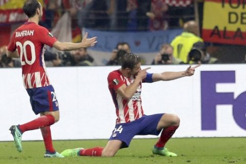 Atletico's Gabi, right, celebrates scoring his side's 3rd goal with his teammate Juanfran during the Europa League Final soccer match between Marseille and Atletico Madrid at the Stade de Lyon in Decines, outside Lyon, France, Wednesday, May 16, 2018. (AP Photo/Laurent Cipriani)