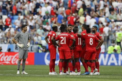 Panama players gather on the pitch at the end of the first half of the group G match between England and Panama at the 2018 soccer World Cup at the Nizhny Novgorod Stadium in Nizhny Novgorod , Russia, Sunday, June 24, 2018. (AP Photo/Alastair Grant)