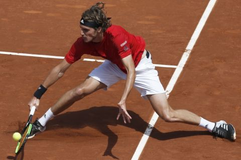Stefanos Tsitsipas of Greece returns the ball in his semifinal match against Spain's Pablo Carreno Busta during the Barcelona Open Tennis Tournament in Barcelona, Spain, Saturday, April 28, 2018. (AP Photo/Manu Fernandez)
